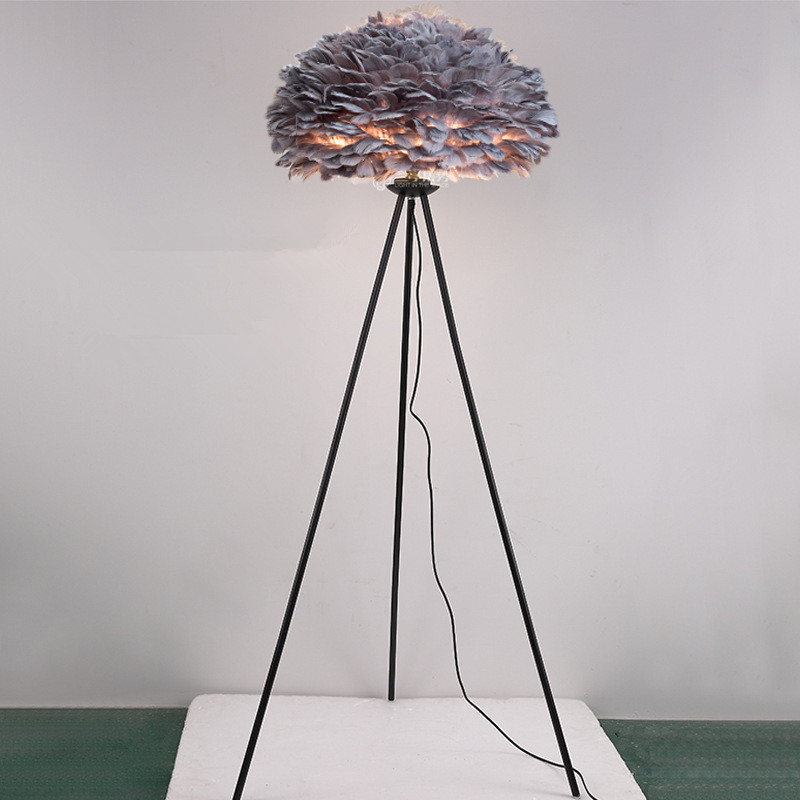 grey feather lamp shade black tripod base floor lamp