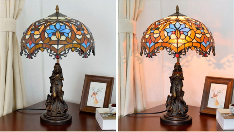 tiffany lamp with angel girl besides lamp