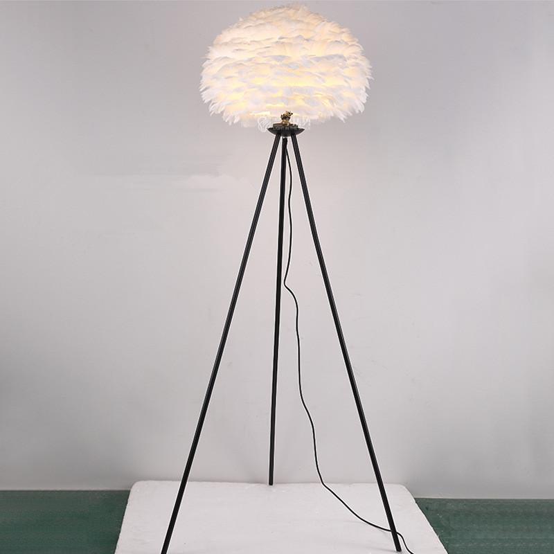 white feather lamp shade black tripod base floor lamp